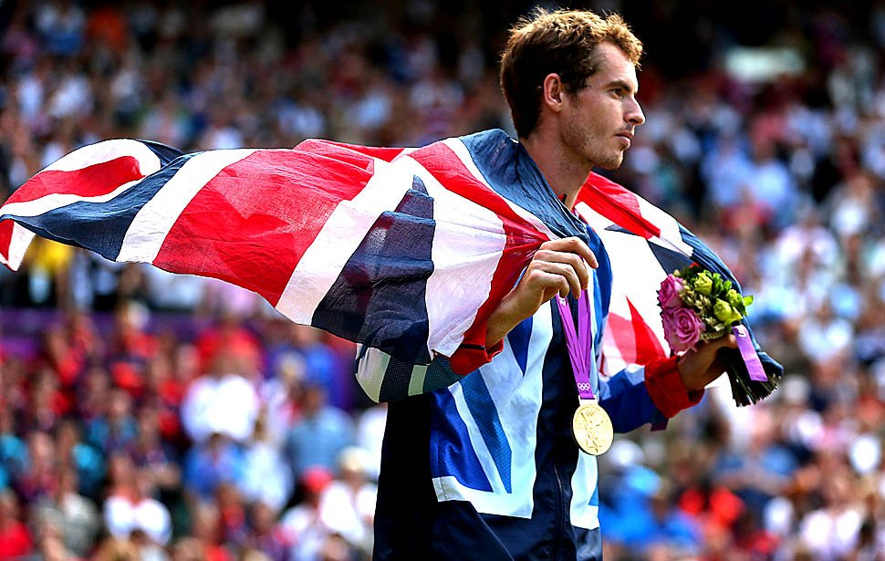 LONDON, ENGLAND, SUNDAY, AUGUST 5, 2012 - Andy Murray soaks up a cool breeze and shows more relief than joy as he parades around Wimbledon's center court with the Union Jack and an Olympic Gold Medal. Murray won the men's tennis final over Switzerland's Roger Federer 3-0 at the London 2012 Olympics. (Robert Gauthier/Los Angeles Times)
