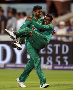 Pakistan's Babar Azam is carried off the pitch by Babar Azam, during the Twenty20 match between England and Pakistan, at Old Trafford, in Manchester, England, Wednesday Sept. 7, 2016. (Martin Rickett/PA via AP)