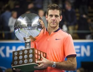 Del Potro poses with the Winner's Trophy.