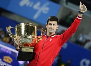 Novak gives a thumbs up after winning yet another China Open title