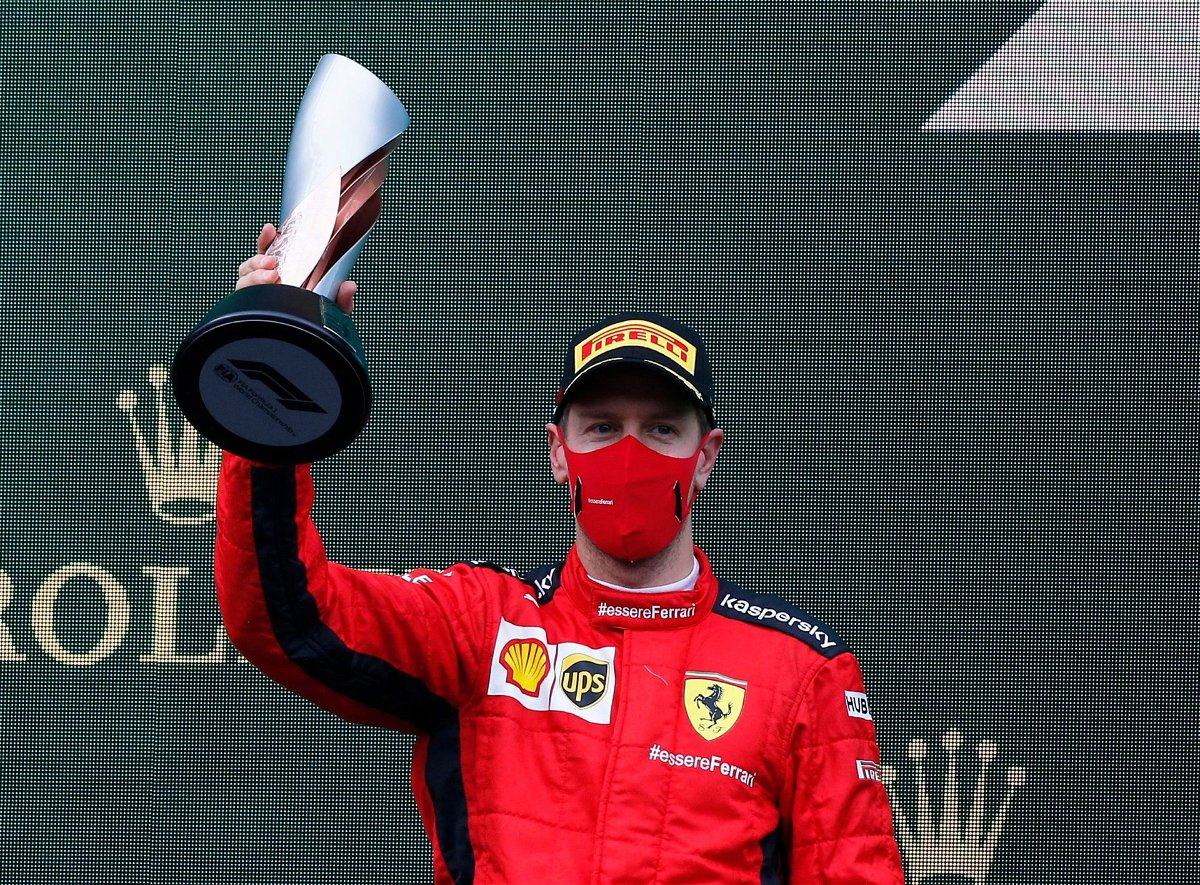 Vettel celebrates on the podium following the Turkish GP race