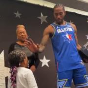 Kawhi Leanard giving a high-five to his daughter