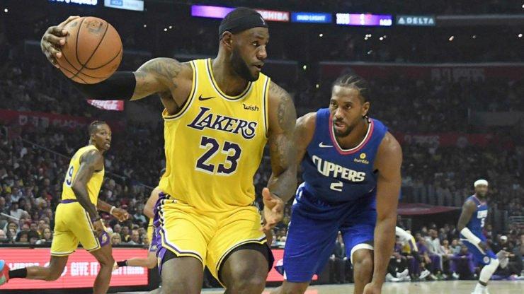 Los Angeles Lakers' LeBron James and Los Angeles Clippers' Kawhi Leonard