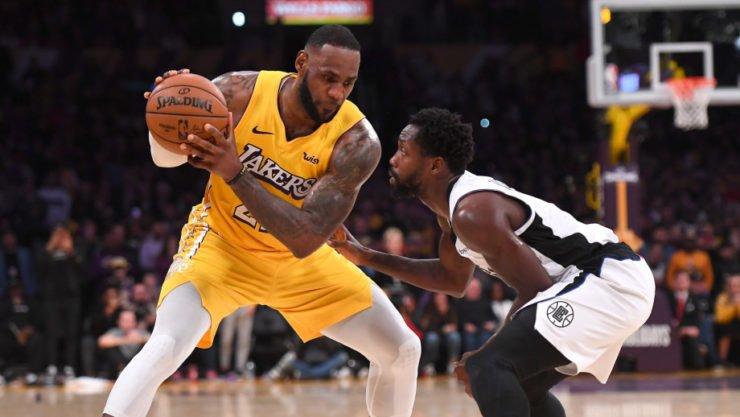 Patrick Beverley guarding Los Angeles Lakers' LeBron James