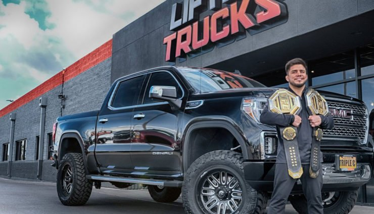 Henry Cejudo with his new custom made car by Lifted Trucks