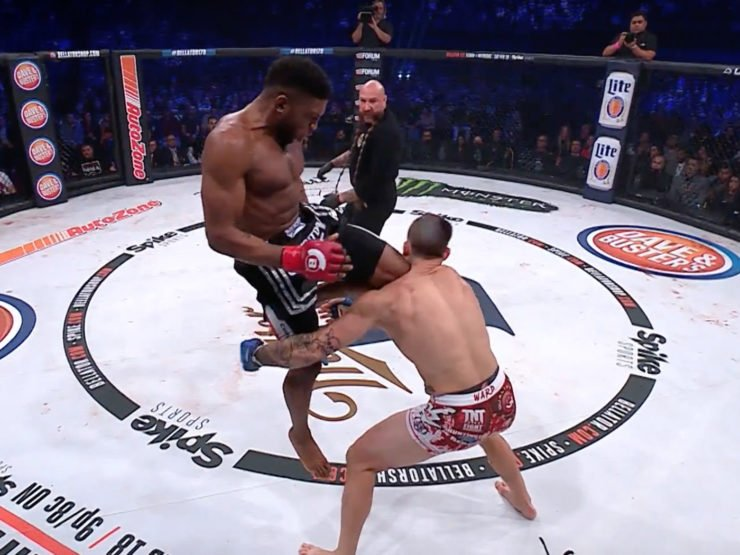 Paul Daley with a flying knee to Brennan Ward