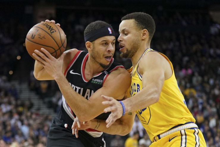 Stephen Curry guarding Seth Curry