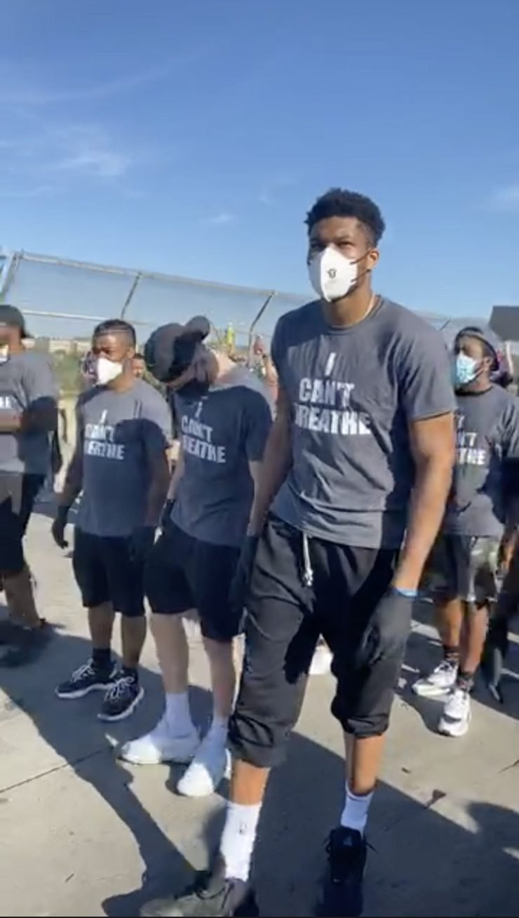 Giannis Antetokounmpo participating in protest