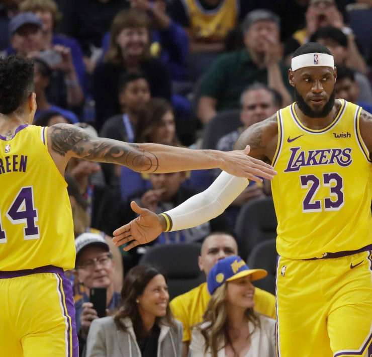 Los Angeles Lakers forward LeBron James (23) celebrates with guard Danny Green (14) during the first half of a preseason NBA basketball game against the Golden State Warriors in San Francisco, Saturday, Oct. 5, 2019.