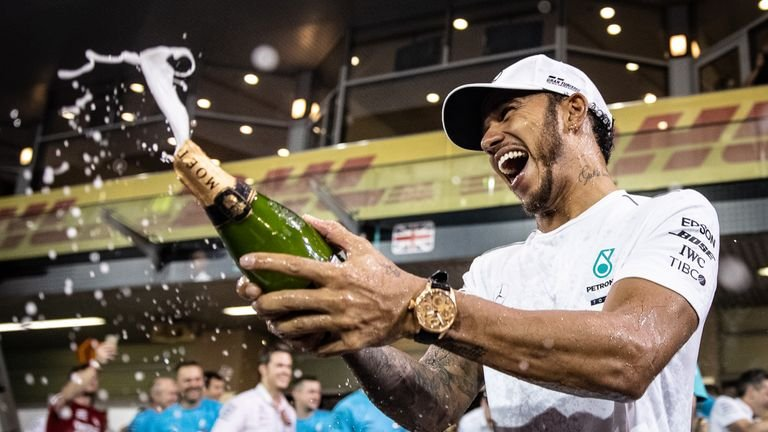 WATCH: Lewis Hamilton Chases Toto Wolff with Champagne Bottle After Styrian GP - Essentially Sports