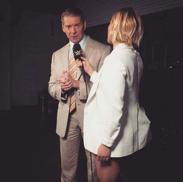 Vince McMahon being interviewed by Renee Young