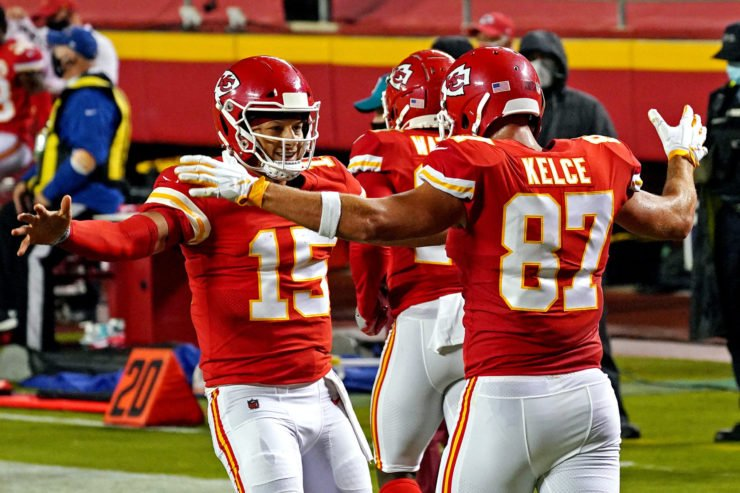 Kansas City Chiefs quarterback Patrick Mahomes (15) and tight end Travis Kelce (87) celebrate in the win over Houston Texans.