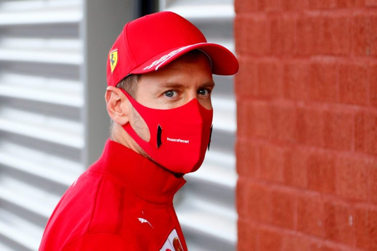 Sebastian Vettel Walks Into The Paddock