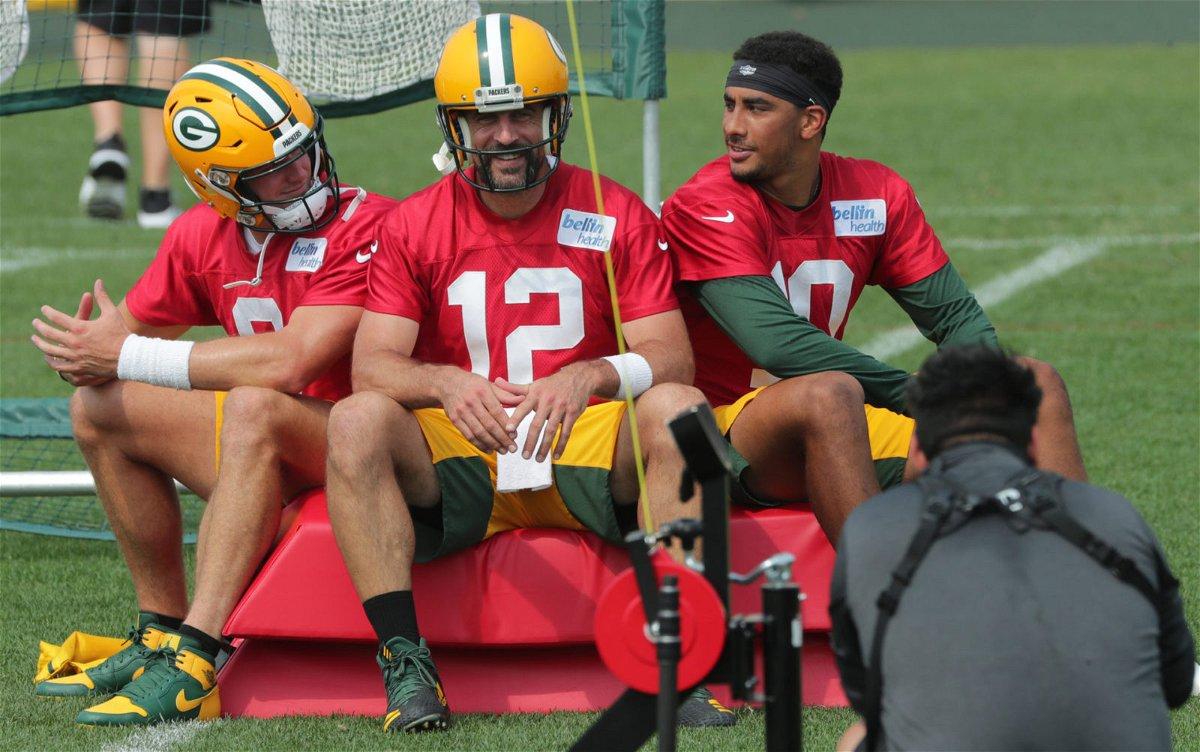 Green Bay Packers quarterback Aaron Rodgers pictured alongside rookie Jordan Love.