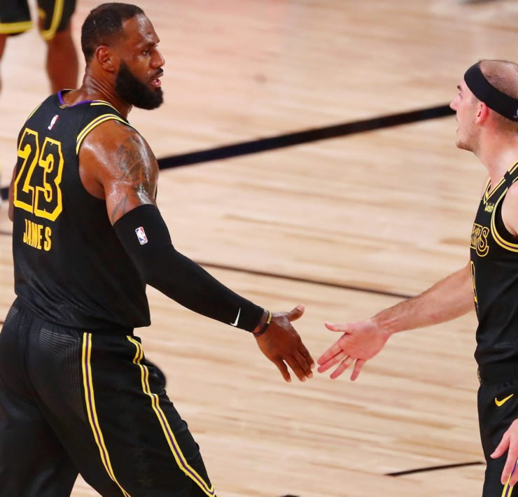 Los Angeles Lakers Star LeBron James celebrating with Alex Caruso