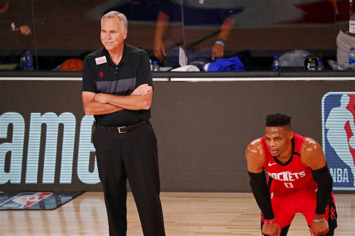 Houston Rockets head coach Mike D'Antoni and guard David Nwaba watch as their team plays in the NBA Playoffs 2020