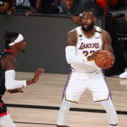 Los Angeles Lakers forward LeBron James controls the ball around Houston Rockets forward Robert Covington in game five of the second round of the 2020 NBA Playoffs.