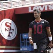 San Francisco 49ers quarterback Jimmy Garoppolo walks to the field during training camp at Levi's Stadium.