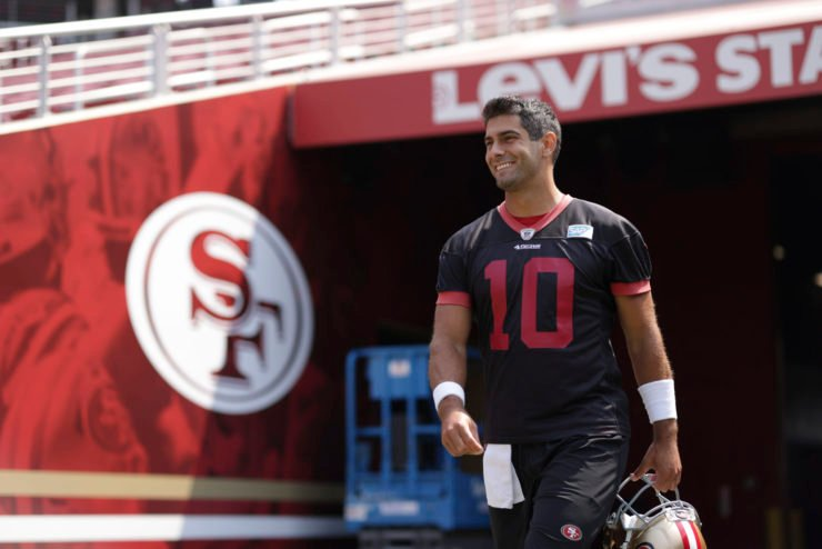 San Francisco 49ers quarterback Jimmy Garoppolo walks to the field during training camp at Levi's Stadium.