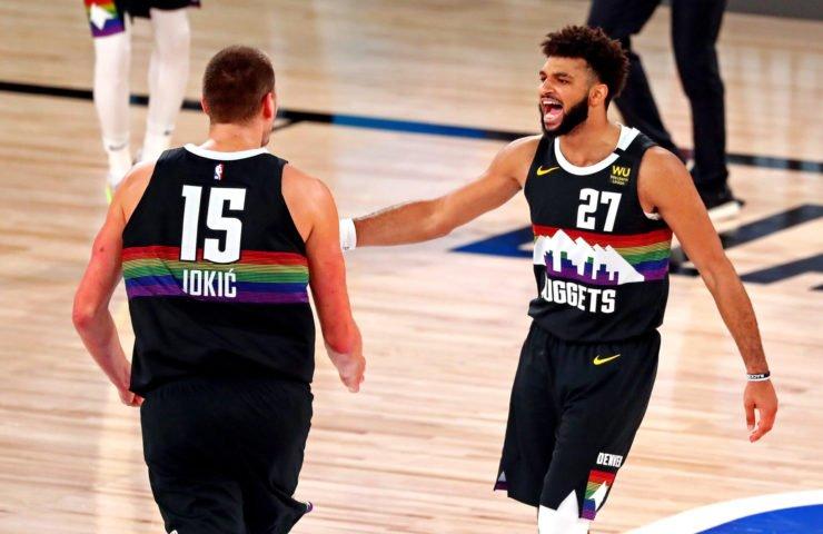Nikola Jokic and Jamal Murray celebrating Denver Nuggets victory over LA Clippers