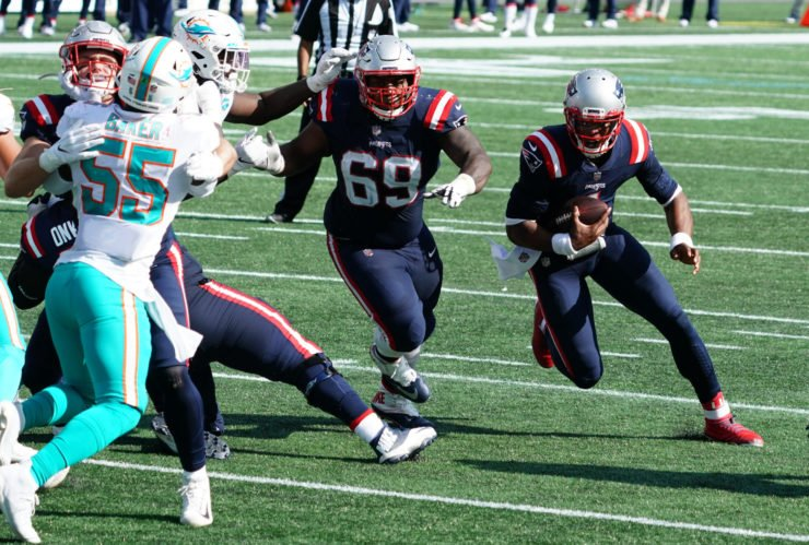 Cam Newton rushes to the endzone for a touchdown against Miami Dolphins