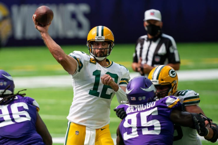 Aaron Rodgers makes a play against Minnesota Vikings in Week One