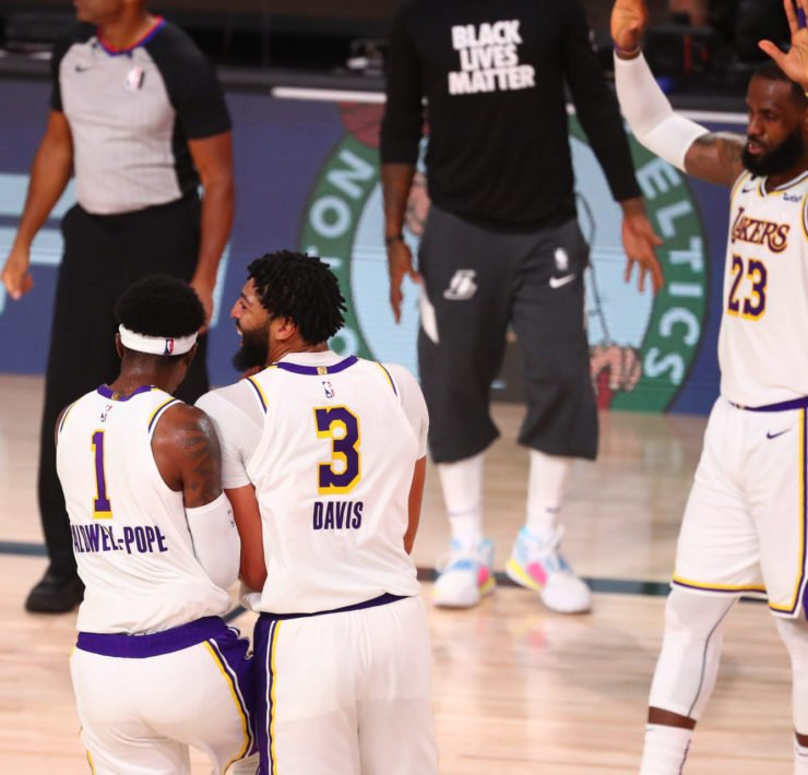 Los Angeles Lakers guard Kentavious Caldwell-Pope, forwards Anthony Davis and LeBron James celebrate after defeating the Houston Rockets
