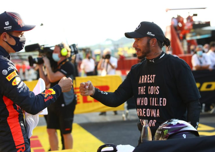 Mercedes' Lewis Hamilton congratulates with Red Bull's Alex Albon after the latter earns his maiden podium