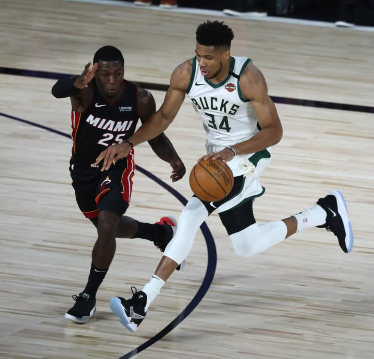 Milwaukee Bucks forward Giannis Antetokounmpo playing against Miami Heat guard Kendrick Nunn