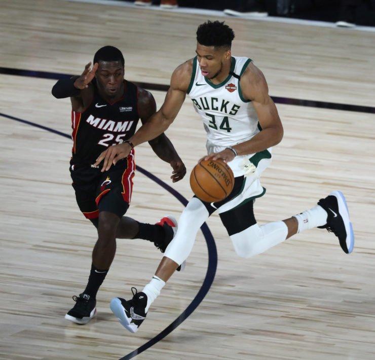 Milwaukee Bucks forward Giannis Antetokounmpo playing against Miami Heat guard Kendrick Nunn