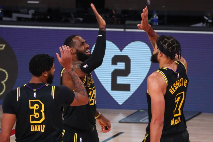 LeBron James of Los Angeles Lakers celebrates with teammates as they wear the Black Mamba Jersey to mark Kobe Bryant's birthday. The picture also captures Giannis Bryant's jersey number '2'.