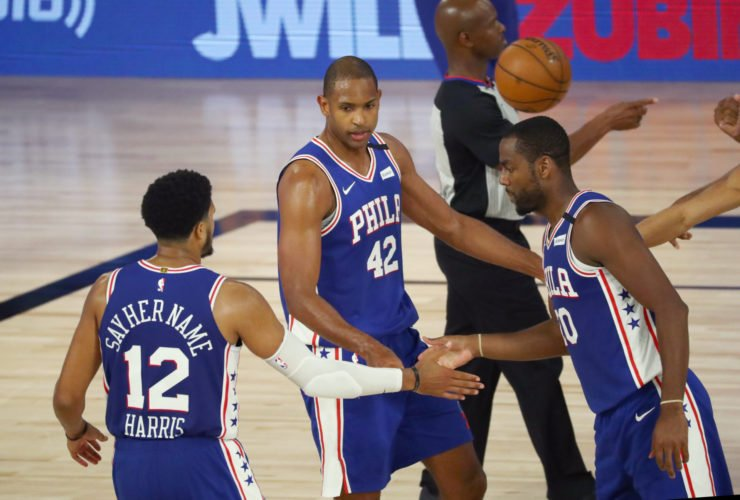 Philadelphia 76ers forward Al Horford (42) celebrates with forward Tobias Harris (12) and guard Alec Burks (20) after scoring against the Boston Celtics during the third quarter in game four of an NBA basketball first-round playoff series at The Field House.