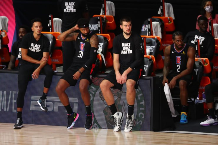 The Los Angeles Clippers sit on the sidelines during the second half in game seven of the second round against the Denver Nuggets.