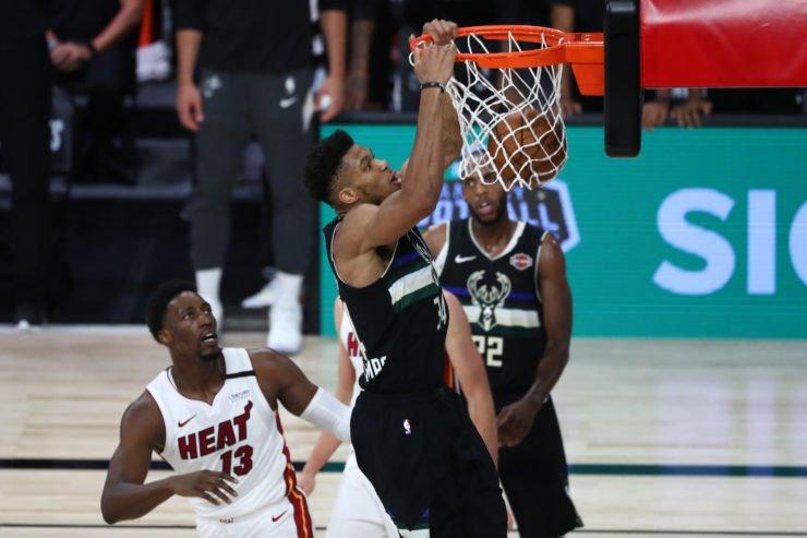 Milwaukee Bucks forward Giannis Antetokounmpo dunks against Miami Heat forward Bam Adebayo.