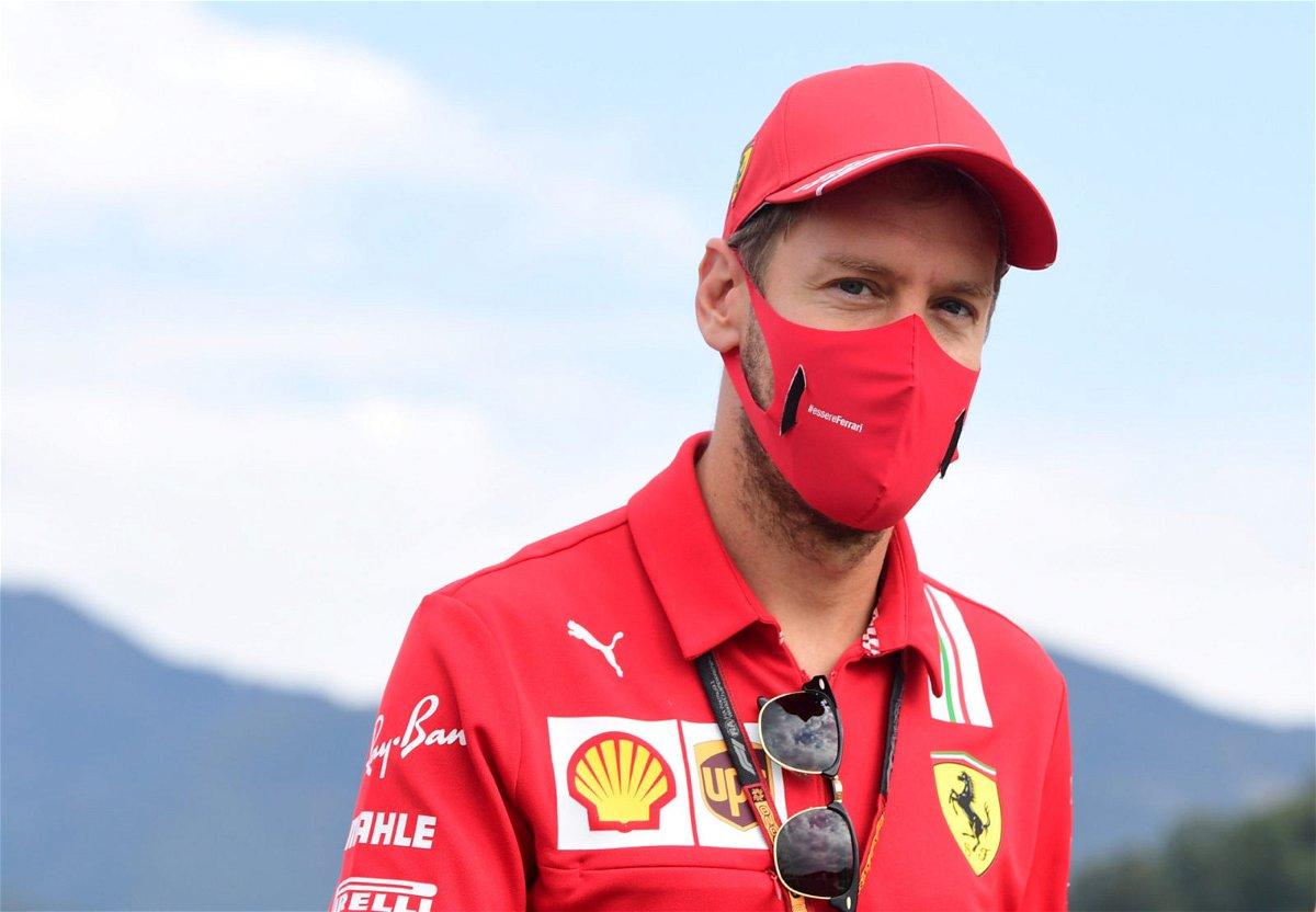 Ferrari driver Sebastian Vettel smiles behind his mask ahead of the Tuscan Grand Prix