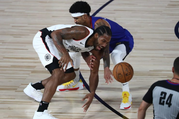 LA Clippers' Kawhi Leonard against Nuggets Gary Harris