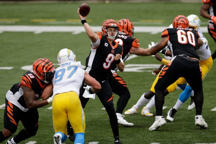 Joe Burrow attempts a pass during Cincinnati Bengals' narrow loss to Los Angeles Chargers