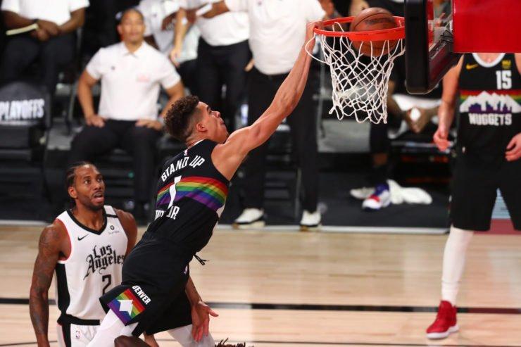 Denver Nuggets forward Michael Porter Jr. dunks over LA Clippers forward Kawhi Leonard
