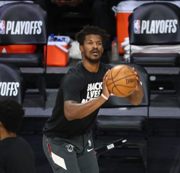 Miami Heat forward Jimmy Butler warms up before a game.