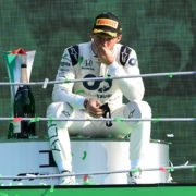 AlphaTauri driver Pierre Gasly soaks in the moment, sitting atop the podium following his maiden win at the Italian Grand Prix