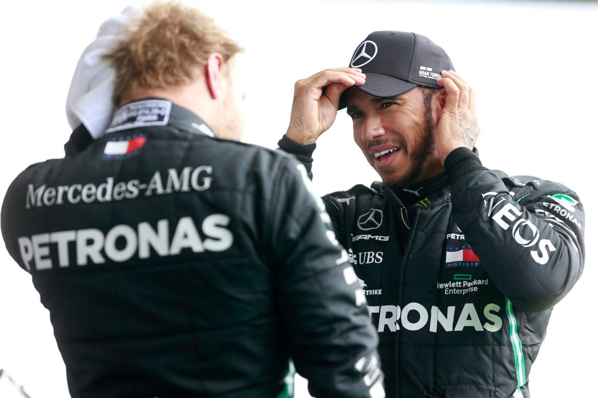 Mercedes' Lewis Hamilton and Valtteri Bottas chat after the F1 Belgian Grand Prix