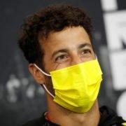 Renault driver Daniel Ricciardo is all smiles at a press conference