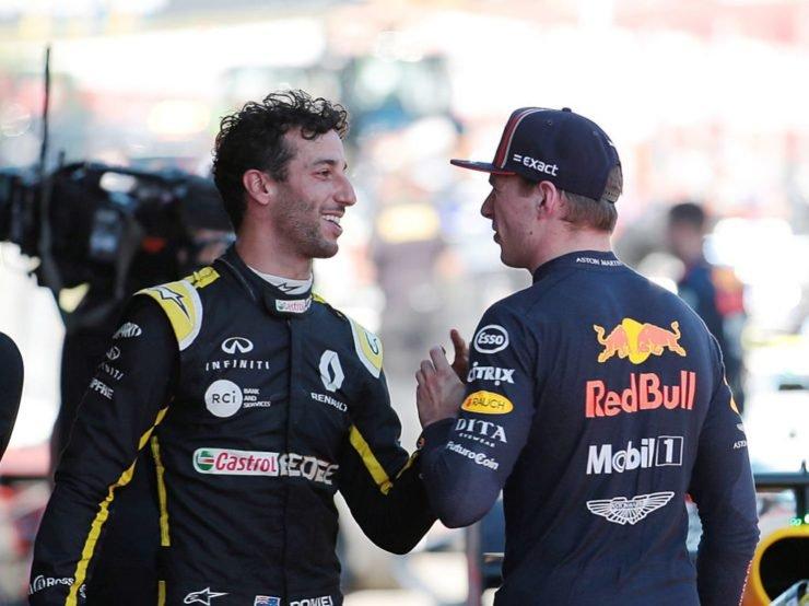 Daniel Ricciardo and Max Verstappen share a light moment.