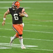 Cleveland Browns quarterback Baker Mayfield runs to complete a first down against Cincinnati Bengals