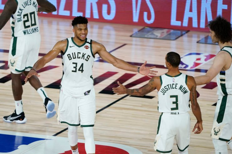 Milwaukee Bucks star Giannis Antetokounmpo celebrates with teammates after defeating the Orlando Magic in the 2020 NBA Playoffs