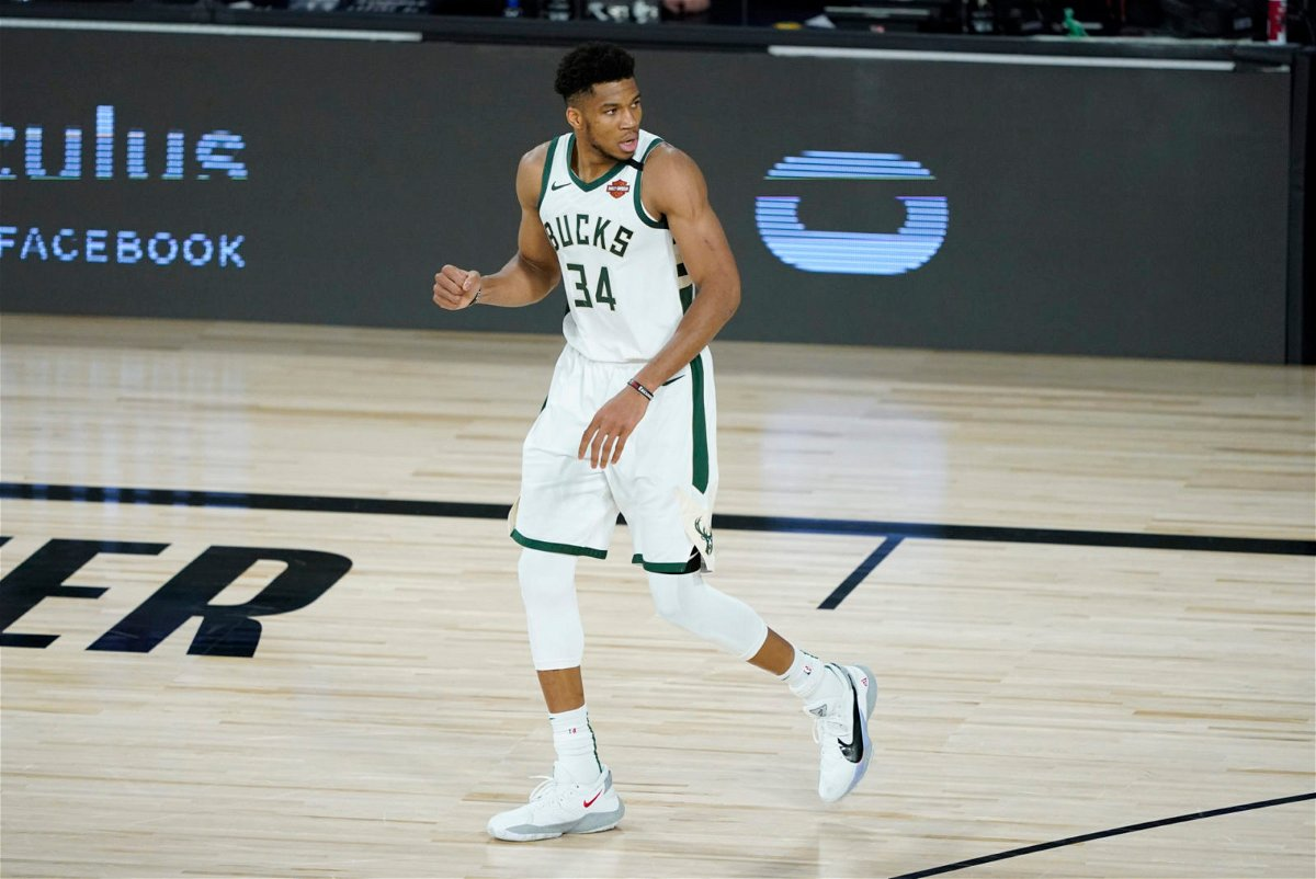 Milwaukee Bucks forward Giannis Antetokoumpo celebrates during a moment in Game 2 against the Orlando Magic in the 2020 NBA Playoffs