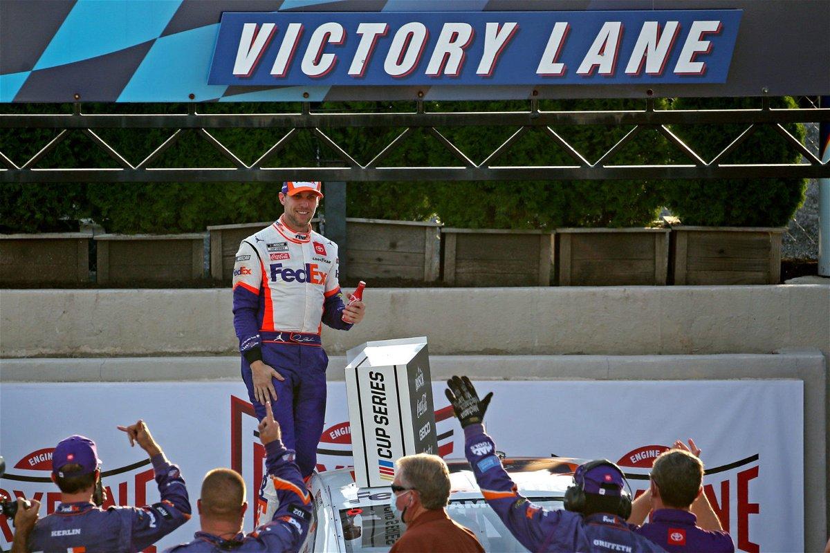 Denny Hamlin celebrates his win