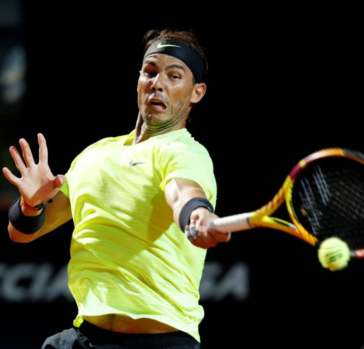 Rafael Nadal returns a shot against Dusan Lajovic in the Italian Open 2020