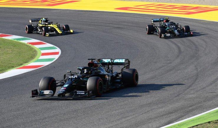 Renault driver Daniel Ricciardo battles with Mercedes' Valtteri Bottas with Lewis Hamilton leading the race in Mugello