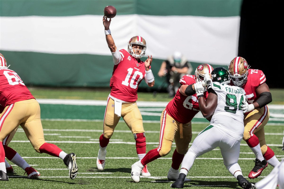 San Francisco 49ers quarterback Jimmy Garoppolo makes a play against New York Jets on Sunday.